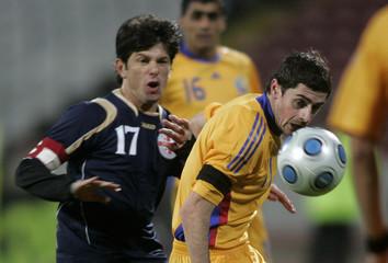 Romania's Cocis challenges Georgia's Levan Kobiashvili during their international friendly soccer match in Bucharest