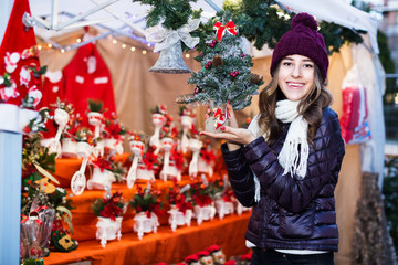 Girl buying Christmas floral compositions