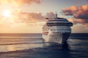 Fototapeta Luxury cruise ship leaving port at sunset obraz
