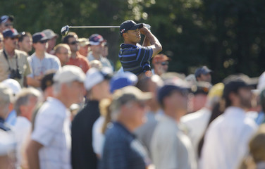 Tiger Woods of the U.S. watches his tee shot on the 14th hole at the Deutsche Bank Championship PGA golf tournament in Norton