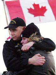 CANADIAN SAILOR HUGS HIS WIFE GOODBYE IN HALIFAX.