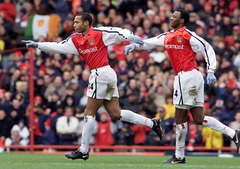 ARSENAL'S HENRY CELEBRATES WITH VIEIRA AFTER SCORING AGAINST LEICESTER AT HIGHBURY.