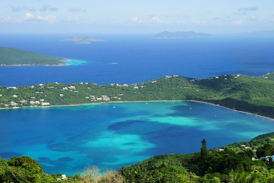 A high point view of Magens Bay, St. Thomas island with multiple other caribbean islands on the background