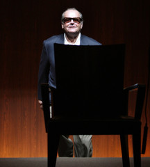 """Actor Jack Nicholson walks onto the stage for a news conference to promote his movie """"The Bucket List"""" in Tokyo"""