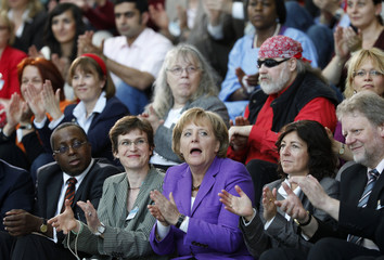 German Chancellor Merkel sits with social workers during a meeting in Berlin