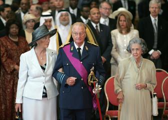 Belgian King Albert II (C), his wife Queen Paola (L) and Queen Fabiola (R), attend the Te Deum mass ..