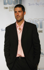 """Matthew Fox, one of the stars of the television series """"Lost"""", poses at the series' DVD release party in ..."""