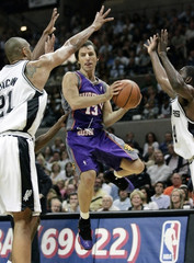 Phoenix Suns' Steve Nash goes to the basket  between San Antonio Spurs Tim Duncan and Michael Finley  during Game 3 of their NBA Western Conference semifinal playoff basketball game in San Antonio