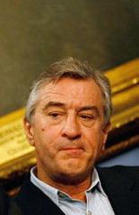 Actor Robert De Niro listens as Rome's Mayor Walter Veltroni speaks during a news conference in New York