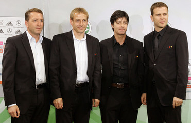 Germany soccer goaltender coach Koepke, coach Klinsmann, assistent coach Loew and team manager Bierhoff pose for the media following a news conference in Berlin