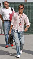 Ferrari World Champion Schumacher of Germany arrives at the Bahrain desert grand prix circuit.