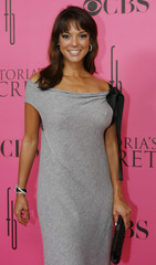 Television personality Eva LaRue arrives on the pink carpet and poses for photographers prior to the  Victoria's Secret Fashion Show at the Fountainbleau Hotel in Miami Beach