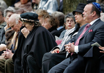 A woman commemorates the 60th anniversary of the liberation of Westerbork Camp in the Netherlands.