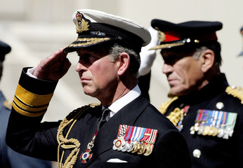 Britain's Prince Charles salutes during memorial service to mark 60th anniversary of VJ Day at Cenotaph ...