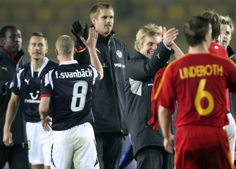 Helsinborg's Svanback high fives with team mates to celebrate after their UEFA Cup soccer match in Istanbul