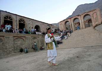 Afghan actor performs during Love's Labours Lost, a play by William Shakespeare, in ruins of ...