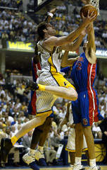 INDIANA PACERS CROSHERE STOPPED BY DETROIT PISTONS PRINCE IN GAME 5.