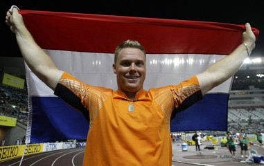 Smith of the Netherlands celebrates after winning the bronze medal in the men's discus throw finals at the 11th IAAF World Athletics Championship in Osaka