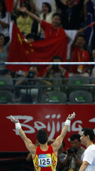 Yang Wei of China finishes his routine on the horizontal bar during the men's individual all-around artistic gymnastics final at the Beijing 2008 Olympic Games