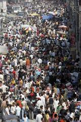 People shop at a market ahead of the Muslim festival of Eid al-Fitr in Srinagar