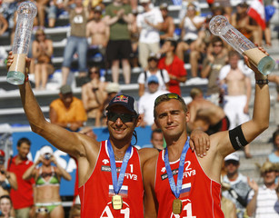 Russia's Kolodinsky and Barsouk react after winning their final match against  the United States at the FIVB Beach volleyball Grand Slam in Klagenfurt