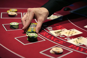 A croupier deals a hand for a poker at the new Casino Barriere in Toulouse