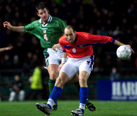 CZECH REPUBLIC'S KOLLER IS TACKLED BY IRELAND'S BUTLER.