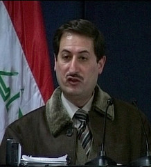 A recent television image shows the Governor of Baghdad Ali al-Haidri speaking at a press conference ...