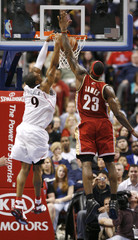 76ers forward Iguodala slam dunks on Cavaliers forward James during the second quarter of NBA basketball action in Philadelphia
