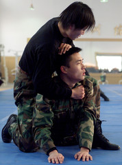 CHINESE POLICE OFFICERS FROM THE SPECIAL POLICE BRIGADE PRACTISE THEIR COMBAT SKILL IN BEIJING.