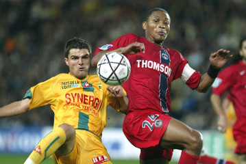 Paris St Germain's Faffan fights for the ball whith Nantes' Daniel Florin Bratu during their French ...