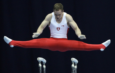 Switzerland's Capelli competes on the parallel bars during qualification competition at the World cup in Artistic Gymnastics in Moscow