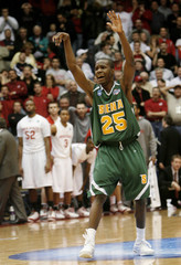 Siena College's Moore celebrates after making a shot against Ohio State University during their NCAA basketball tournament game in Dayton
