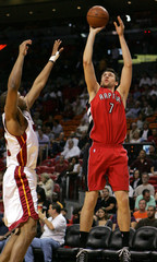 Toronto Raptors center Andrea Bargnani of Italy shoots over Miami Heat forward Alexander Johnson during their NBA basketball game in Miami