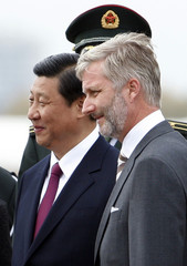 China's Vice President Xi Jinping is welcomed by Belgium's Crown Prince Philippe in Brussels