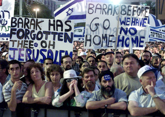 Tens of thousands of Israelis take part in a demonstration against the Camp David summit July 16. Th..