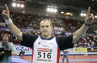 Slovakia's Konopka celebrates winning the men's shot put event during the European indoor athletics championships at the National Indoor Arena in Birmingham