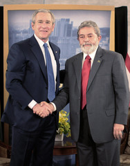 U.S. President Bush shakes hands with Brazilian President da Silva in Sao Paulo