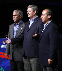 Canada's PM Harper gestures while standing with U.S. President Bush and Mexico's President Calderon at North American Leaders' Summit in Montebello