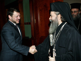 Jordan's King Abdullah welcomes the new Greek Orthodox Patriarch ,of the Holy Land Theofilos III, in Amman