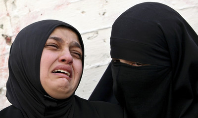 Palestinian women cry during the funeral of 15-year-old Ibrahim Sanakreh in Balata refugee camp