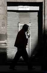 A man walks past the front of El Nivel bar in Mexico City