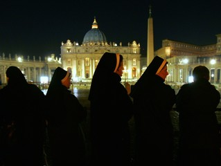 Nuns wait to enter St. Peter's Square in the early hours before Pope John Paul II's funeral at ...