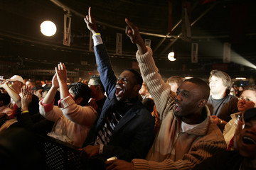Fans cheer during the Live Earth concert at The Dome in Johannesburg