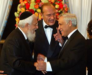 FRENCH PRESIDENT CHIRAC SPEAKS TO ISRAELI PRESIDENT KATSAV AND CHIEF RABBI SITRUK IN PARIS.