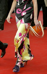 Guest wears geometric print evening dress during red carpet arrivals at the 57th Cannes Film Festiva..