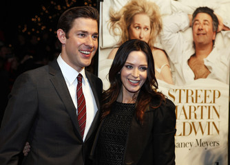 Cast member John Krasinski and his fiancee actor Emily Blunt arrive for the premiere of It's Complicated in New York
