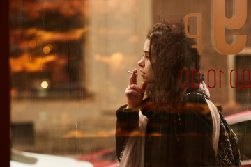 A girl smoking at a cafe of Saint Peterburg