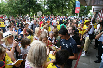 Bad Kissingen's residents have their autographs signed by members of the Ecuador team outside a hotel in Bad Kissingen