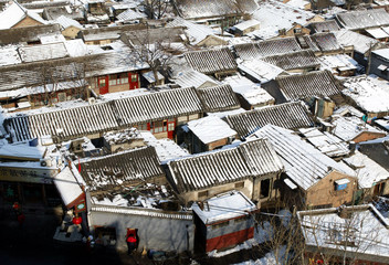 Traditional Beijing courtyard houses are blanketed with snow in China's Captial January 22, 2003. Re..